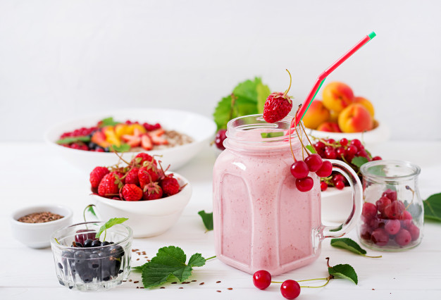 yoghurt-strawberry-smoothies-in-a-jar-on-a-white-background_2829-1207